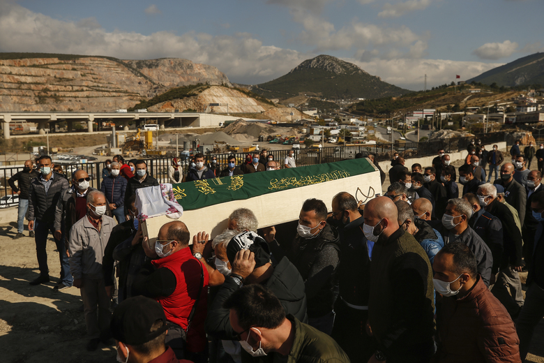 Mourners carry the coffin of Fidan Gezgin, killed at her house when it collapsed during the Oct. 30 earthquake, during the funeral procession in Izmir, Turkey, Wednesday, Nov. 4, 2020. Fidan was the mother of Ayda Gezgin who was pulled alive from the rubble of the same building by rescue services Tuesday, some four days (91 hours) after the strong earthquake hit Turkey and Greece. (AP Photo/Emrah Gurel)