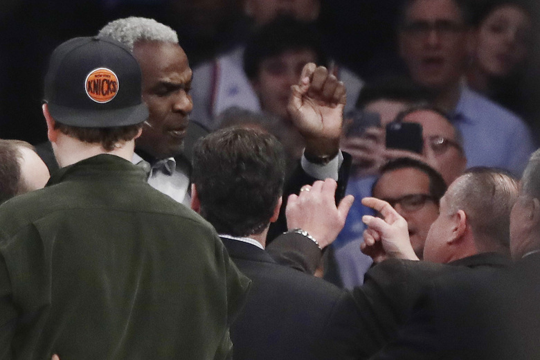 FILE – In this Feb. 8, 2017 file photo, former New York Knicks player Charles Oakley exchanges words with a security guard during the first half of an NBA basketball game between the New York Knicks and the LA Clippers, in New York's Madison Square Garden. A jury can decide whether former New York Knicks star  Oakley was ejected from Madison Square Garden with excessive force when he was removed as a spectator to a 2017 game, an appeals court ruled Monday. (AP Photo/Frank Franklin II, File)