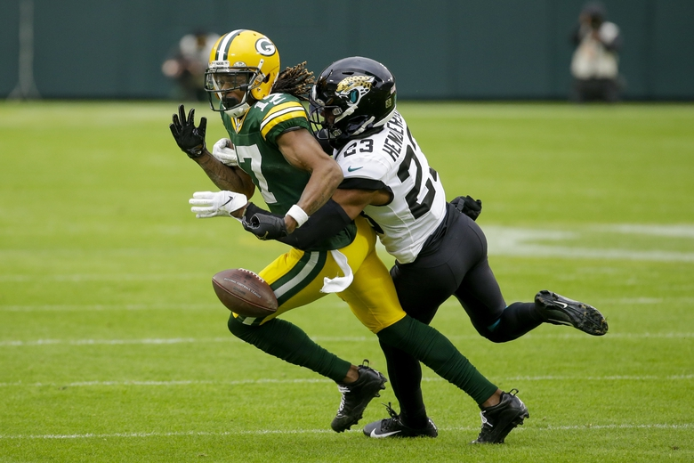 Jacksonville Jaguars' C.J. Henderson knocks the ball away from Green Bay Packers' Davante Adams after a catch during the second half of an NFL football game Sunday, Nov. 15, 2020, in Green Bay, Wis. The Jaguars recovered the fumble. (AP Photo/Mike Roemer)