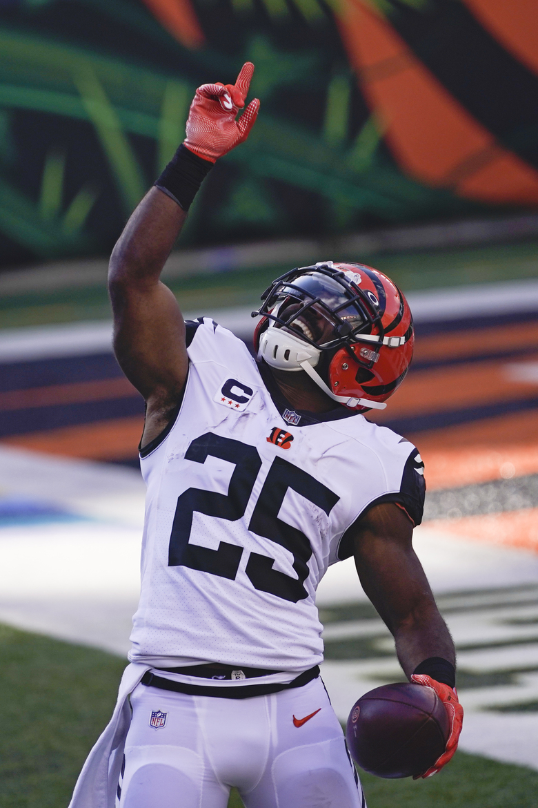 Cincinnati Bengals' Giovani Bernard (25) celebrates after rushing for a touchdown during the first half of an NFL football game against the Tennessee Titans, Sunday, Nov. 1, 2020, in Cincinnati. (AP Photo/Bryan Woolston)