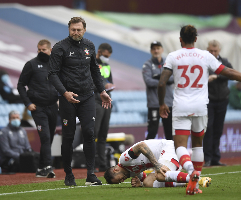 FILE – In this Sunday, Nov. 1, 2020 file photo, Southampton's manager Ralph Hasenhuettl reacts as his player Southampton's Danny Ings is injured during the English Premier League soccer match between Aston Villa and Southampton at Villa Park in Birmingham, England. Ings will undergo knee surgery which will result in him being sidelined for at least one month, the Premier League club said Wednesday, Nov. 4, 2020. (Gareth Copley/Pool via AP, File)