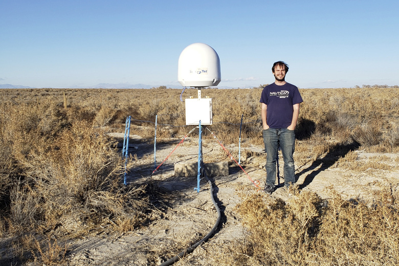 CORRECTS TO NOV. 4 NOT NOV. 5 – This undated photo provided by Caltech shows radio astronomer Christopher Bochenek with a STARE2 station he developed near the town of Delta, Utah. On Wednesday, Nov. 4, 2020, astronomers say they used this system and a Canadian observatory to trace an April 2020 fast cosmic radio burst to our own galaxy and a type of powerful energetic young star called a magnetar. (Caltech via AP)