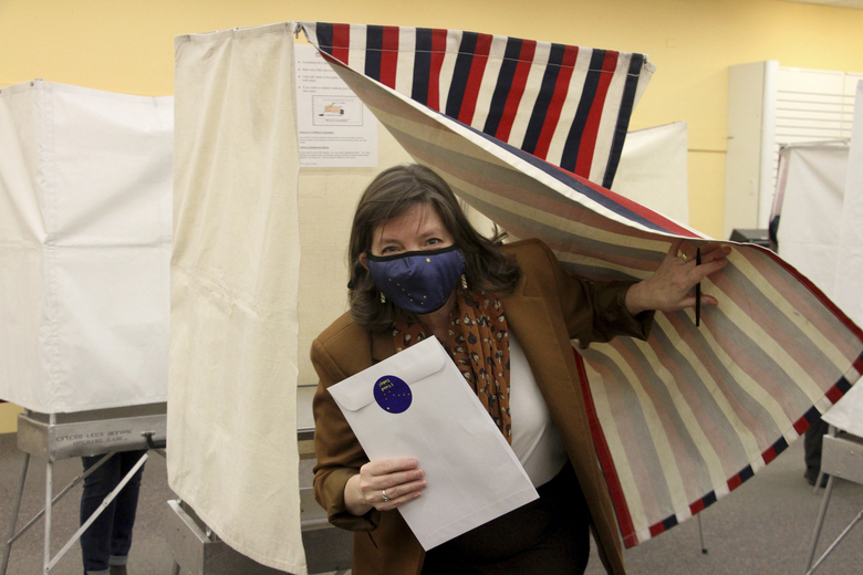Alyse Galvin emerges from the voting booth after casting her early vote Friday, Oct. 30, 2020, in Anchorage, Alaska. Galvin, an independent, is trying to unseat U.S. Rep. Don Young, Alaska's sole member of the U.S. House and in office since 1973. (AP Photo/Mark Thiessen)