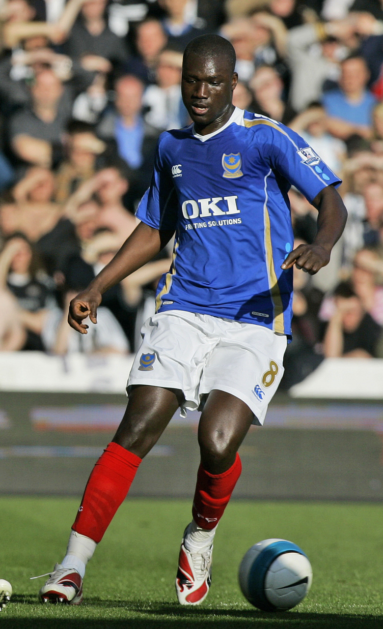 """FILE – In this file photo dated Saturday, April 12, 2008, Portsmouth's Papa Bouba Diop, in action against Newcastle during their English premier League soccer match at Fratton Park Stadium in Portsmouth, England. Papa Bouba Diop, the tall Senegal midfielder who scored the goal that delivered one of the greatest upsets in World Cup history, has died aged 42, """"FIFA is saddened to learn of the passing of Senegal legend Papa Bouba Diop,"""" the sport's governing body said Sunday Nov. 29, 2020.(AP Photo/Kirsty Wigglesworth, FILE)"""