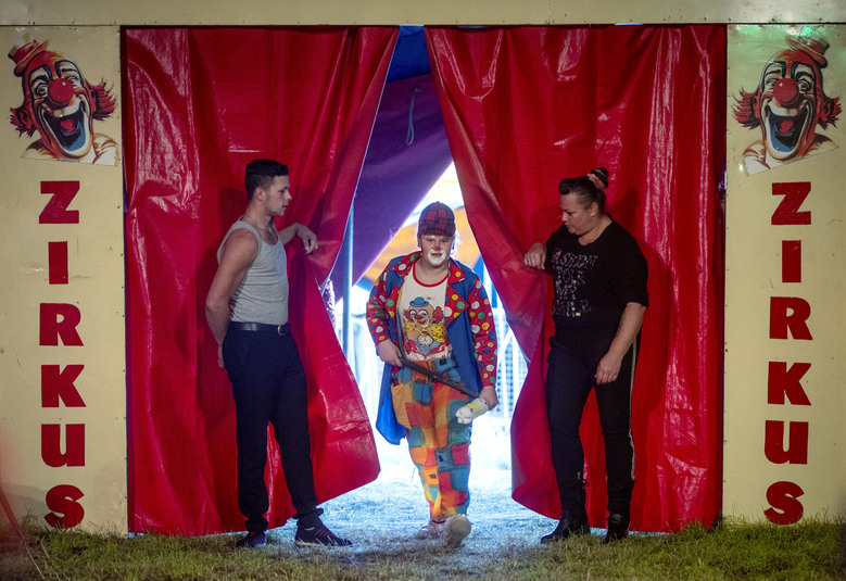 13-year-old clown Pepita walks through the curtain during a performance of small circus Delmonde in Frankfurt, Germany, Saturday, Oct. 31, 2020. As Germany embarks Monday on a four-week partial lockdown, the family-run circus joins theaters, cinemas, sports facilities, restaurants and bars across the country in shutting down and hoping for the best. (AP Photo/Michael Probst)