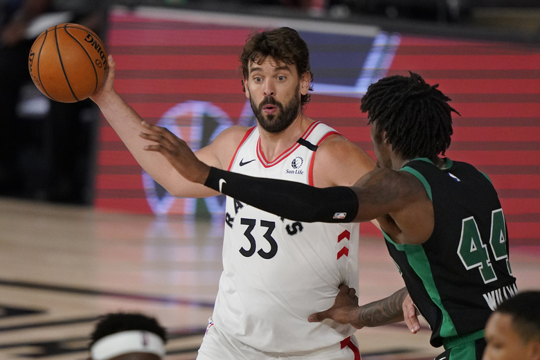 FILE – In this Sept. 1, 2020, file photo, Toronto Raptors' Marc Gasol (33) looks to pass as Boston Celtics' Robert Williams III (44) defends in the first half of an NBA conference semifinal playoff basketball game in Lake Buena Vista, Fla. The Los Angeles Lakers have signed veteran Spanish center Marc Gasol on Tuesday, Nov. 24, 2020. (AP Photo/Mark J. Terrill, File)