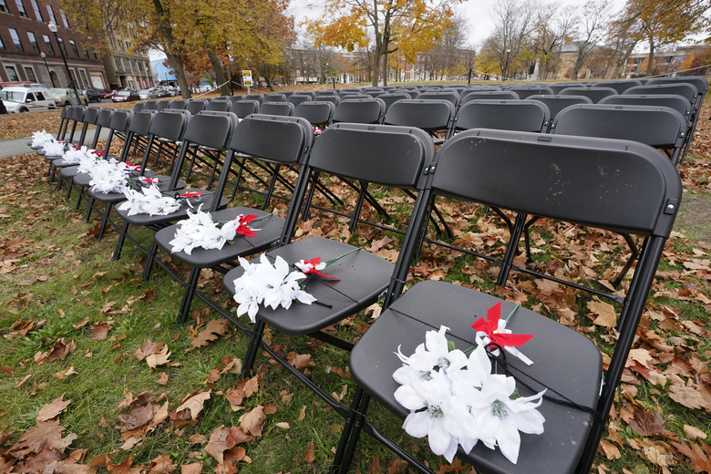 The COVID-19 Empty Chair Memorial is seen on display at Campagnone Common, Nov. 11, 2020, in Lawrence, Mass. Each chair represents a person from Lawrence who has died from coronavirus. Once a coronavirus hot spot, Massachusetts was seen as a model for infection control this summer as coronavirus cases and deaths dwindled. Now, experts are warning the state could be headed for a bleak winter as its cases climb once again and confirmed deaths surpass 10,000. Massachusetts hit 10,015 confirmed coronavirus deaths on Thursday, Nov. 12, 2020 nearly nine months after the state's initial case was detected. (AP Photo/Elise Amendola)