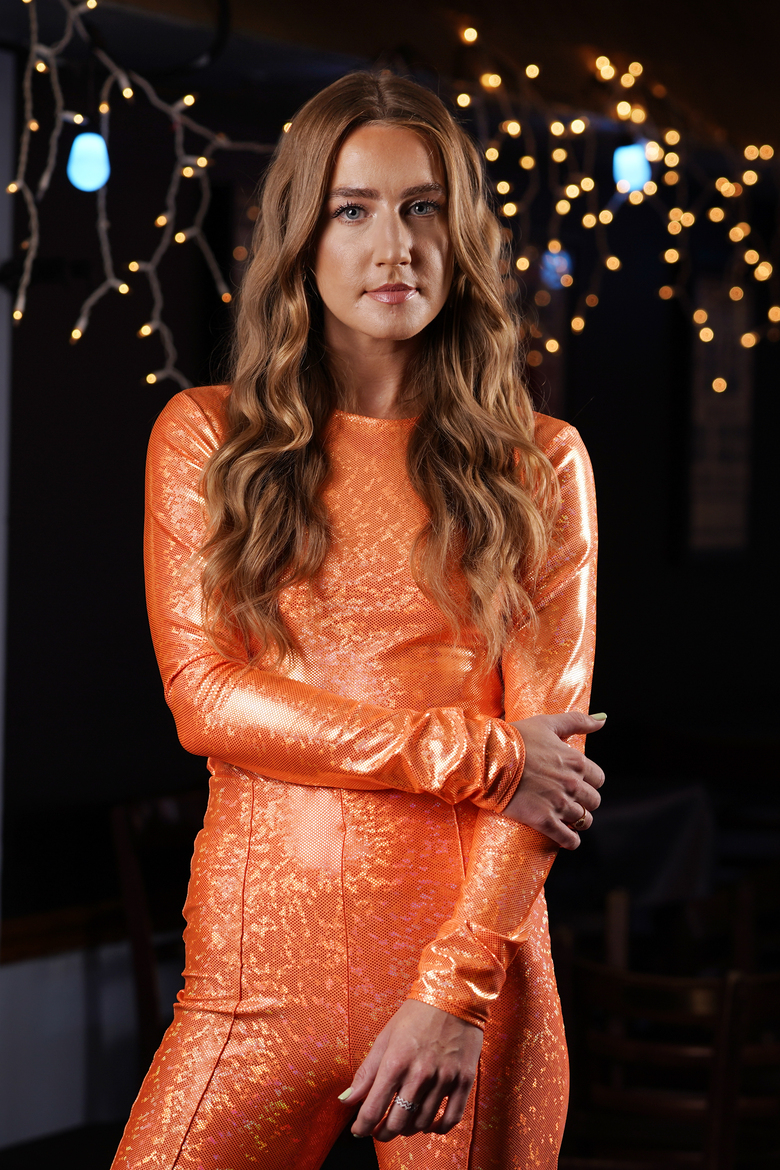 """Musician Ingrid Andress poses in Nashville, Tenn., on Oct. 1, 2020, to promote her album """"Lady Like."""" (AP Photo/Mark Humphrey)"""