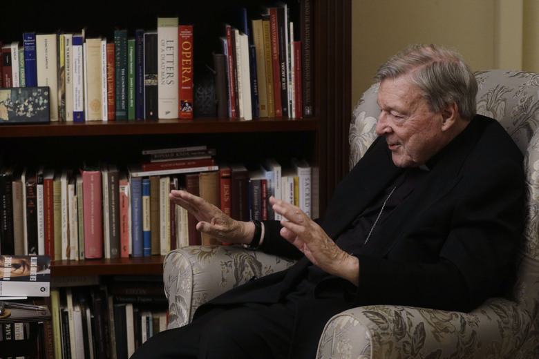 Cardinal George Pell answers a question during an interview with the Associated Press inside his residence near the Vatican in Rome, Monday, Nov. 30, 2020. The pope's former treasurer, who was convicted and then acquitted of sexual abuse in his native Australia, said Monday he feels a dismayed sense of vindication as the financial mismanagement he tried to uncover in the Holy See is now being exposed in a spiraling Vatican corruption investigation. (AP Photo/Gregorio Borgia)