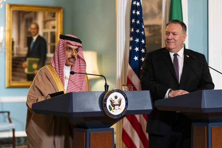FILE – In this Oct. 14, 2020 file photo, Secretary of State Mike Pompeo, right, listens to Saudi Minister of Foreign Affairs Prince Faisal bin Farhan Al Saud speaks during their meeting at the State Department, in Washington. While many nations have sent congratulatory messages to President-elect Joe Biden, so far Saudi Arabia remains silent. Biden has promised to end U.S. support for the kingdom's war in Yemen. (AP Photo/Manuel Balce Ceneta, Pool, File)
