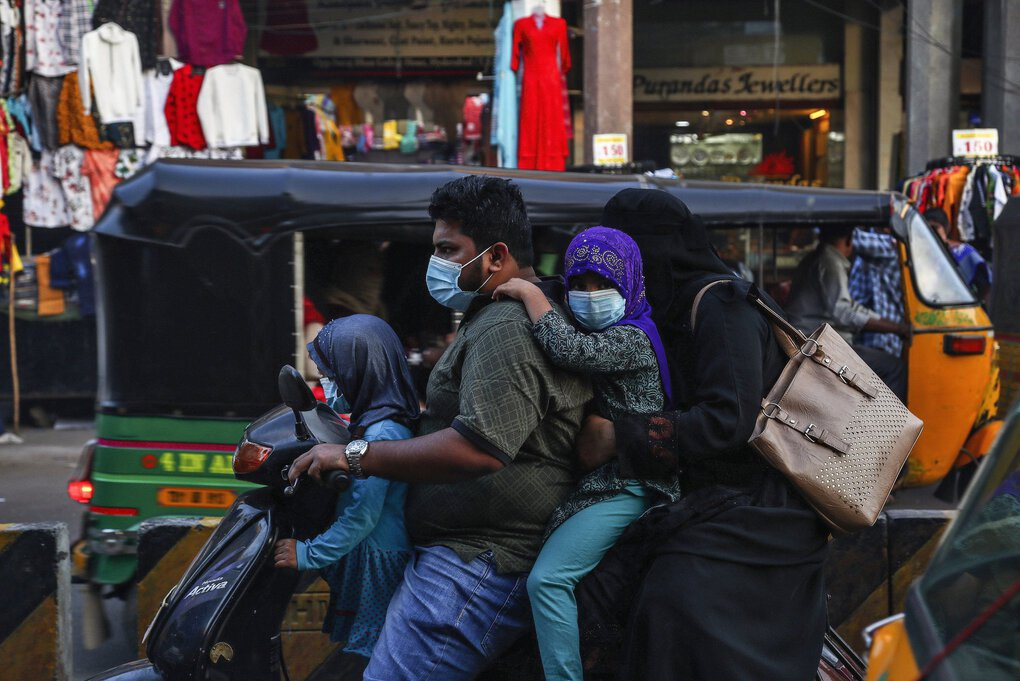 An Indians family wearing face masks as a precaution against the coronavirus rides on a scooter through a street in Hyderabad, India, Wednesday, Dec. 9, 2020. India has more than 9 million cases of coronavirus, second behind the United States.(Mahesh Kumar A / The Associated Press)