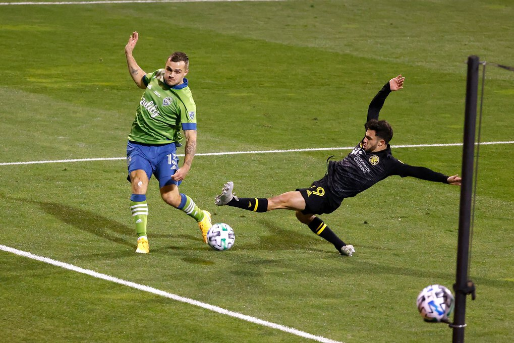 Columbus Crew SC defender Milton Valenzuela (19) deflects the shot by Seattle Sounders FC midfielder Jordan Morris (13) out of bounds during the 2020 MLS Cup on Saturday, December 12, 2020 in Columbus, Ohio. Columbus defeated Seattle 3-0 to win the 2020 MLS Cup. (Kirk Irwin / Special to The Seattle Times)