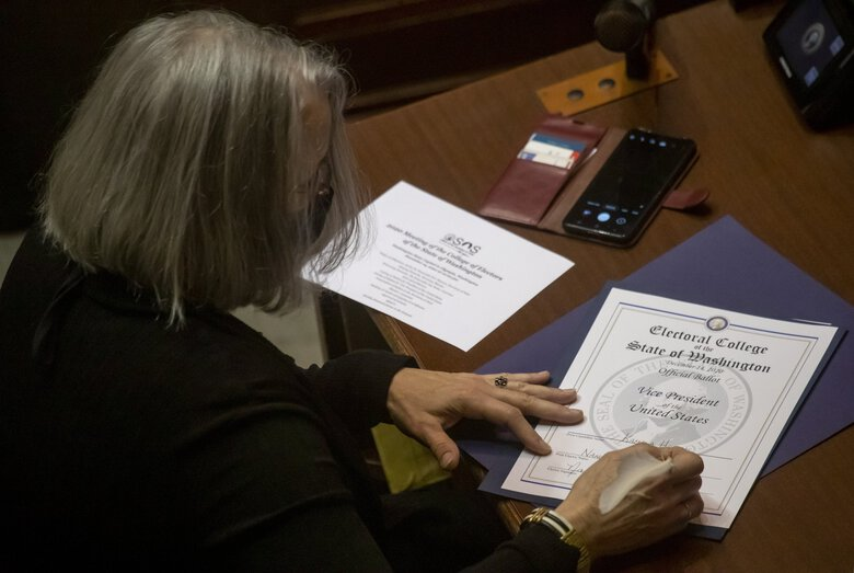 Washington's presidential electors cast the state's 12 Electoral College votes and confirmed Joe Biden as president and Kamala Harris as vice president Monday at the state Capitol in Olympia. (Erika Schultz / The Seattle Times)