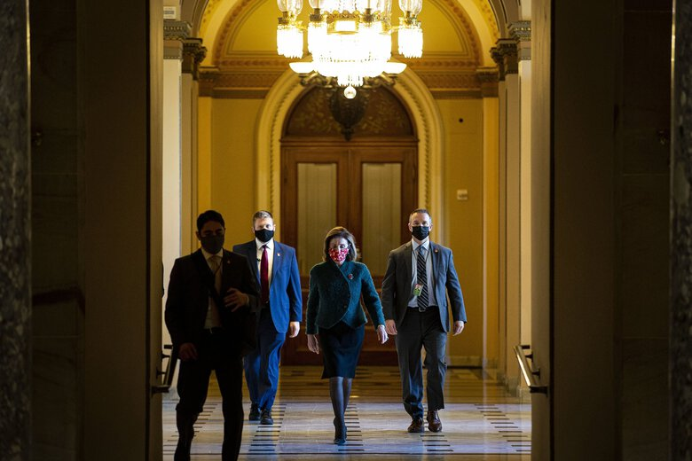 House Speaker Nancy Pelosi (D-Calif.) walks to her office after opening the House floor at the Capitol on Monday, Dec. 28, 2020. (Al Drago/The New York Times)