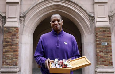 Professor Ed Taylor, with box of cranes, the University of Washington's vice provost and dean of undergraduate academic affairs, seen on campus Tuesday, Dec. 29, 2020 in Seattle. Taylor designed a UW course on 2020, which culminates in creating a time capsule, which will include the paper cranes he folded off screen during meetings and a box local high school students made.  216017