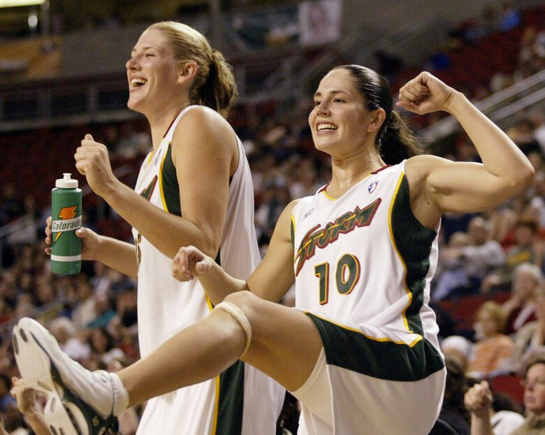 Seattle Storm's Sue Bird (10) and Lauren Jackson cheer from the bench in the second half of the Storm's 93-53 win over the San Antonio Silver Stars in Seattle, Sunday, June 22, 2003. (AP Photo/John Froschauer)