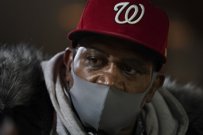 Julius Booker was laid off from his job as a cook in March and has been struggling to pay his bills. He is photographed Dec. 21, 2020. (Washington Post photo by Jahi Chikwendiu)