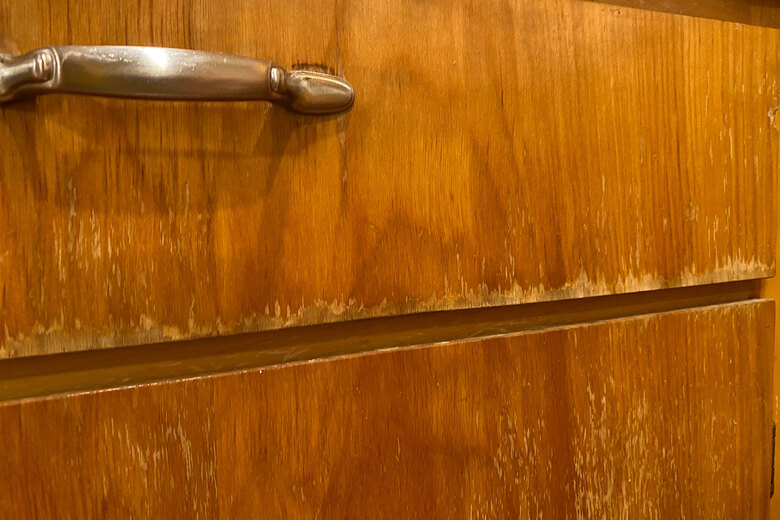 The author wanted to refinish these cabinets without fully removing the stain. (Courtesy of Jeff Layton)