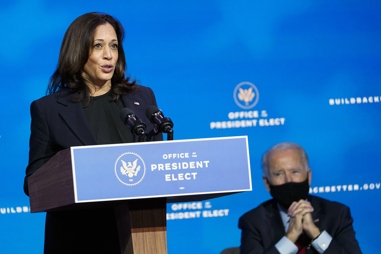 FILE – In this Dec. 8, 2020, file photo President-elect Joe Biden, right, listens as Vice President-elect Kamala Harris, left, speaks during an event at The Queen theater in Wilmington, Del. Black voters were a critical part of the coalition that clinched Biden's White House bid. The nation will swear in its first Black woman and first person of South Asian descent as vice president, Harris. (AP Photo/Susan Walsh, File)