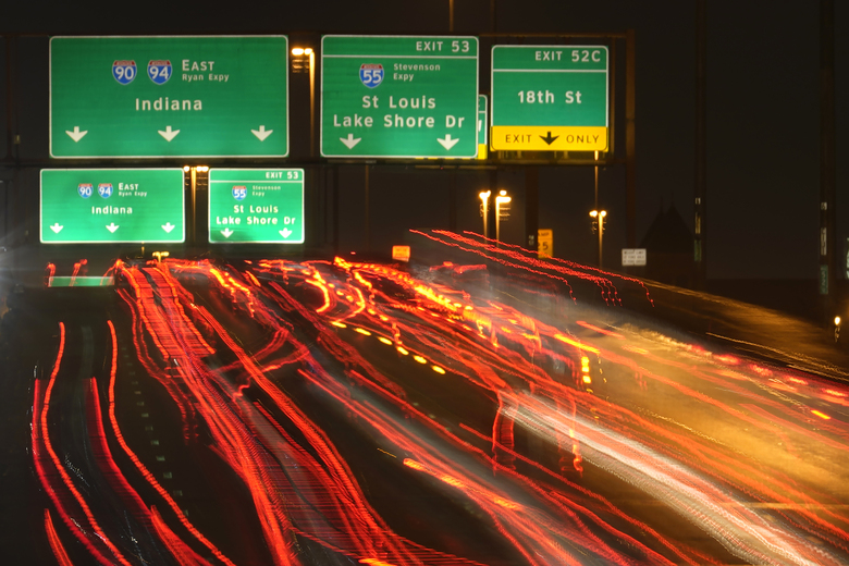 FILE – In this Nov. 24, 2020, file photo, motorists travel south along Interstates 90 and 94 in Chicago. Data from roadways and airports shows millions could not resist the urge to gather on Thanksgiving, even during a pandemic.(AP Photo/Charles Rex Arbogast, File)