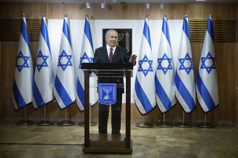 """Israeli Prime Minister Benjamin Netanyahu delivers a statement at the Israeli Knesset, or Parliament, in Jerusalem, Tuesday, Dec. 22, 2020. Netanyahu said, """"We did not want elections, but we will win."""" (Yonatan Sindel/Pool Photo via AP)"""