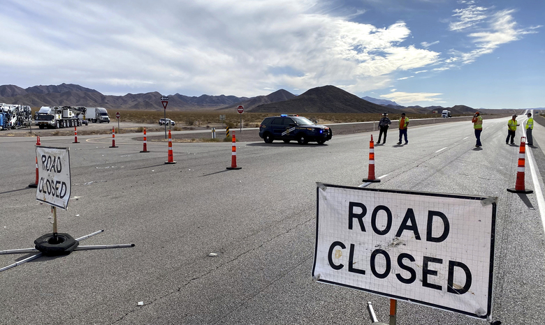 Highway 95 is closed after at least five bicyclists have been killed and four others injured in a crash involving a box truck Dec. 10 near Boulder City, Nev. (Christopher DeVargas/Las Vegas Sun via AP)