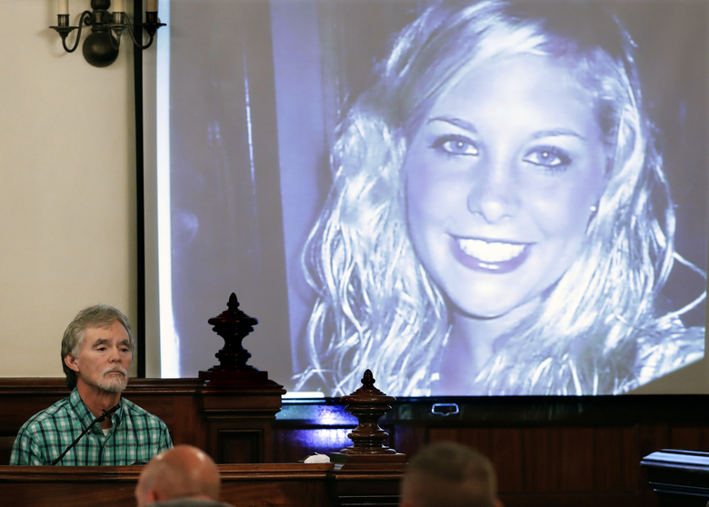 FILE – In this Sept. 11, 2017 file photo, Dana Bobo, left, father of Holly Bobo testifies in the trial of Zachary Adams as a photo of Holly Bobo is displayed in Savannah, Tenn. Jason Autry, a convicted felon who was released from prison after his trial testimony helped convict Adams in the slaying of nursing student Holly Bobo, has been arrested and charged with weapons and drug offenses after he tried to run away from a sheriff's deputy last week.   (AP Photo/Mark Humphrey, Pool, File)