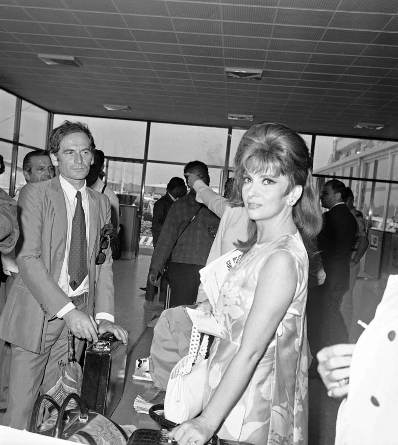 FILE – In this Sept.7, 1967 file photo, Italy's Gina Lollobrigida and French designer Pierre Cardin arrive at the Venice airport to attend the Venice International Film Festival. France's Academy of Fine Arts says famed fashion designer Pierre Cardin has died at 98 (AP Photo, File)