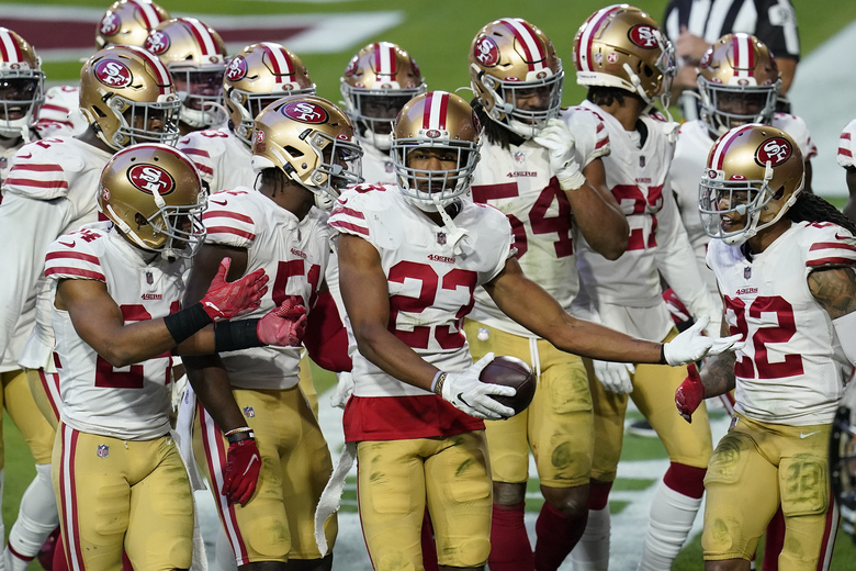 San Francisco 49ers cornerback Ahkello Witherspoon (23) celebrates his interception against the Arizona Cardinals during the second half of an NFL football game, Saturday, Dec. 26, 2020, in Glendale, Ariz. (AP Photo/Ross D. Franklin)