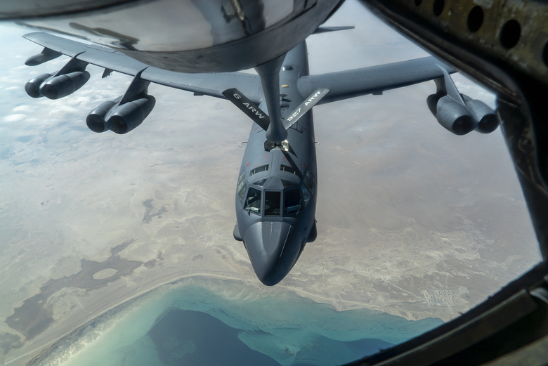 """A U.S. Air Force B-52H """"Stratofortress"""" from Minot Air Force Base, N.D., is refueled by a KC-135 """"Stratotanker"""" in the U.S. Central Command area of responsibility Wednesday, Dec. 30, 2020. The United States flew strategic bombers over the Persian Gulf on Wednesday for the second time this month, a show of force meant to deter Iran from attacking American or allied targets in the Middle East. (Senior Airman Roslyn Ward/U.S. Air Force via AP)"""