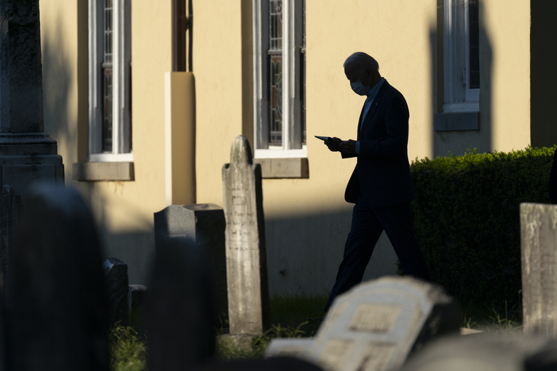 """FILE – In this Sept. 20, 2020, file photo Democratic presidential candidate and former vice president Joe Biden walks from St. Joseph on the Brandywine, a Roman Catholic Church, after attending Mass in Wilmington, Del. Biden says Americans should be allowed to attend church during the pandemic """"safely,"""" and his transition team has underscored the importance of heeding local restrictions. Still, if he does become a regular Washington churchgoer, Biden will have plenty of choices. (AP Photo/Carolyn Kaster, File)"""
