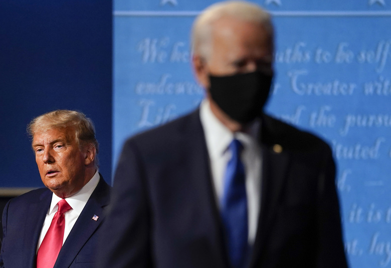 FILE – President Donald Trump, left, remains on stage as then-Democratic presidential candidate former Vice President Joe Biden, right, walks away Thursday, Oct. 22, 2020, at Belmont University in Nashville, Tenn. President Trump's extraordinary effort to overturn Joe Biden's win in Wisconsin returns to the courtroom on Friday, Dec. 11, 2020 with hearings in federal and state lawsuits seeking to invalidate hundreds of thousands of ballots and give the GOP-controlled Legislature the power to name Trump the winner. (AP Photo/Julio Cortez, file)