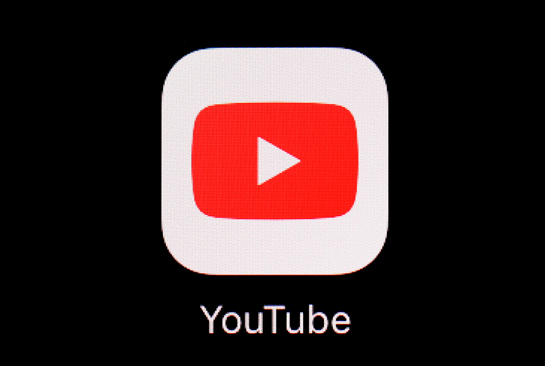 """FILE – This March 20, 2018, file photo shows the YouTube app on an iPad. More than a month after the U.S. presidential election, YouTube says it will start removing newly uploaded material that claims widespread voter fraud or errors changed the outcome. The Google-owned video service said Wednesday, Dec. 9, 2020 that this is in line with how it has dealt with past elections. That's because Tuesday was the """"safe harbor"""" deadline for the election and YouTube said enough states have certified their results to determine Joe Biden as the winner.  (AP Photo/Patrick Semansky, File)"""