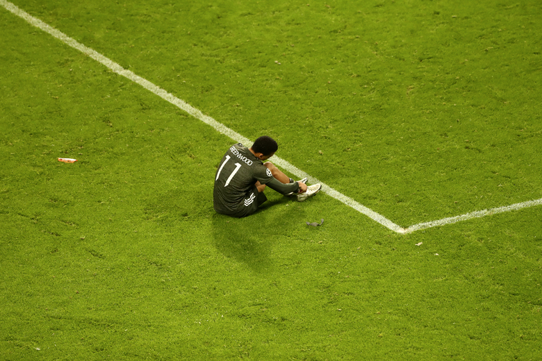 Manchester United's Mason Greenwood sits on the ground after the Champions League group H soccer match between RB Leipzig and Manchester United at the RB Arena in Leipzig, Germany, Tuesday, Dec. 8, 2020. (AP Photo/Matthias Schrader)
