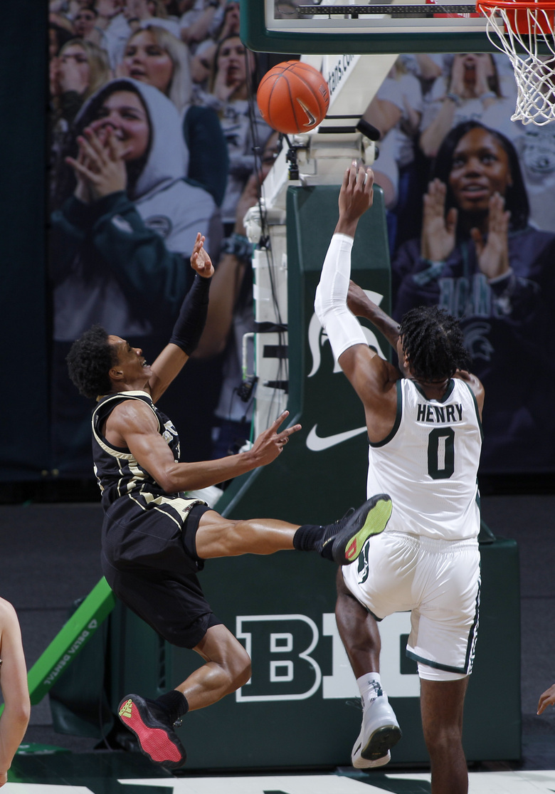 Western Michigan's B Artis White, left, puts up a shot against Michigan State's Aaron Henry during the first half of an NCAA college basketball game, Sunday, Dec. 6, 2020, in East Lansing, Mich. (AP Photo/Al Goldis)