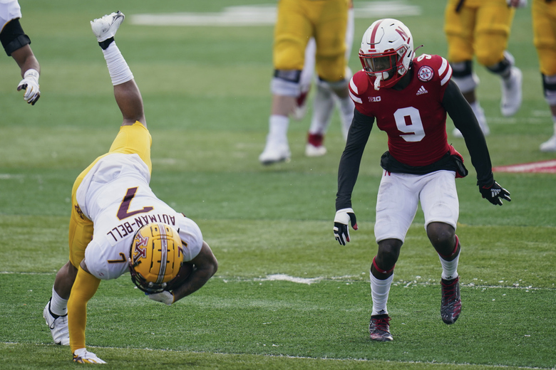 Nebraska safety Marquel Dismuke (9) watches as Minnesota wide receiver Chris Autman-Bell (7) tumbles following a tackle by Nebraska linebacker JoJo Domann, unseen, during the first half of an NCAA college football game in Lincoln, Neb., Saturday, Dec. 12, 2020. (AP Photo/Nati Harnik)