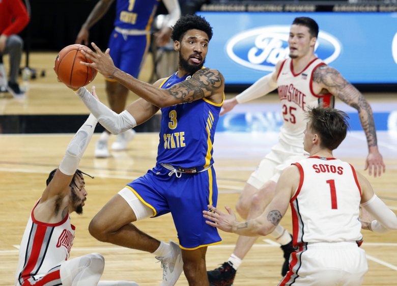 Morehead State forward James Baker (3) looks to pass between Ohio State guard Duane Washington (4), forward Kyle Young (25) and guard Jimmy Sotos (1) during the first half of an NCAA college basketball game in Columbus, Ohio, Wednesday, Dec. 2, 2020. (AP Photo/Paul Vernon)