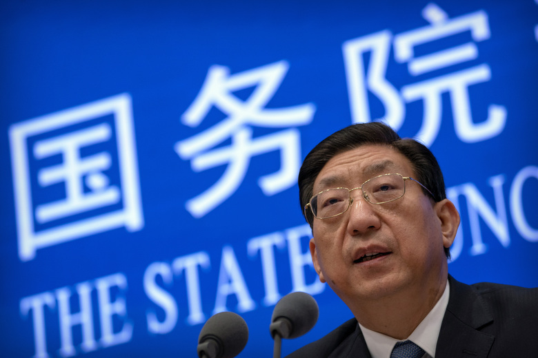 Zeng Yixin, vice minister of China's National Health Commission, speaks during a press conference about the rollout of China's COVID-19 vaccination program at the State Council Information Office in Beijing, Saturday, Dec. 19, 2020. China says it will soon begin coronavirus inoculations for workers in the health care, transport and border control sectors. Zeng said on Saturday the government was prioritizing those most at risk of catching the virus, without giving specifics. (AP Photo/Mark Schiefelbein)