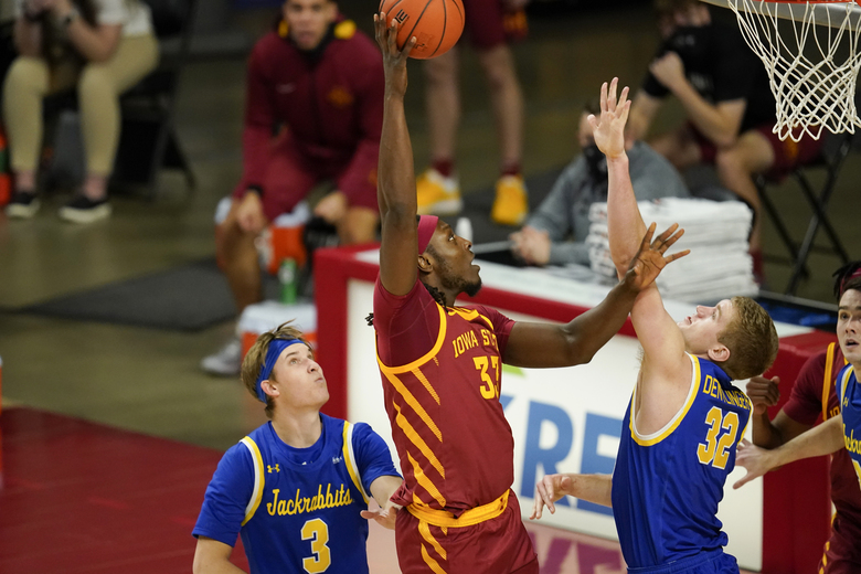 Iowa State forward Solomon Young, center, shoots between South Dakota State guard Baylor Scheierman (3) and forward Matt Dentlinger (32) during the second half of an NCAA college basketball game, Wednesday, Dec. 2, 2020, in Ames, Iowa. (AP Photo/Charlie Neibergall)