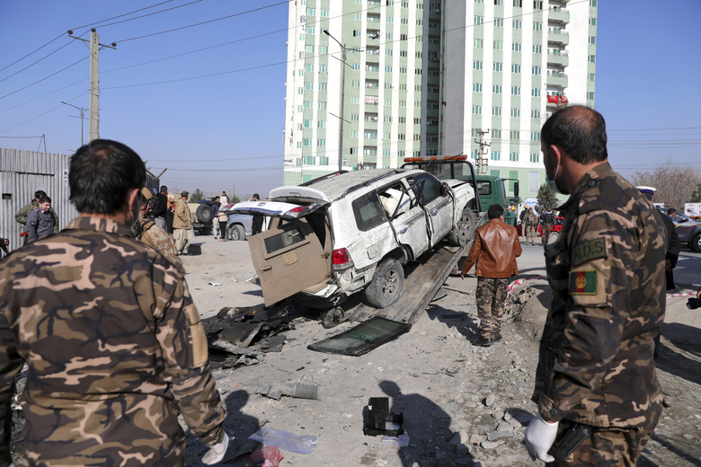 Afghan security personnel inspect the site of a bomb attack in Kabul, Afghanistan, Tuesday, Dec. 15, 2020. A bombing and a shooting attack on Tuesday in the Afghan capital of Kabul killed a few people, including a deputy provincial governor, officials said.(AP Photo/Rahmat Gul)