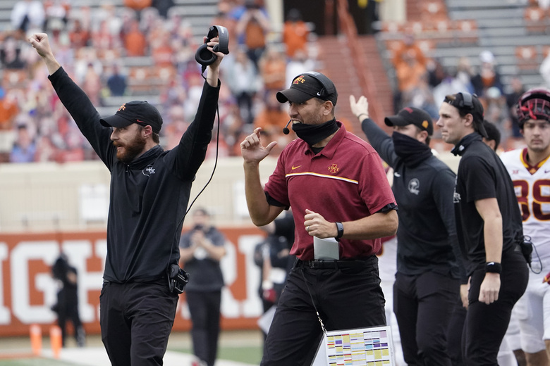 FILE – Iowa State head coach Matt Campbell, center, reacts with other team mambers during the second half of an NCAA college football game against Texas in Austin, Texas, in this Friday, Nov. 27, 2020, file photo. The Cyclones, who at No. 8 have their highest ranking ever in The Associated Press poll, play No. 12 Oklahoma on Saturday, Dec. 19, 2020, at AT&T Stadium in Arlington, Texas. (AP Photo/Eric Gay, File)