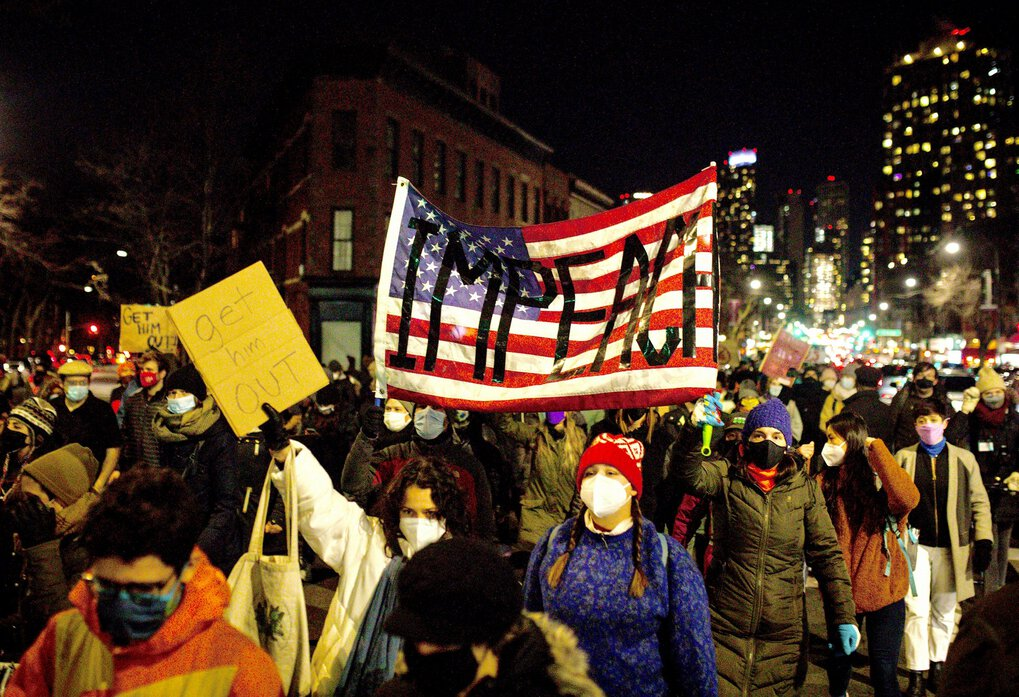 Demonstrators march from Barclays Center to Senate Minority Leader Chuck Schumer's (D-N.Y.) apartment building in New York, on Jan. 7, 2021, as they call for the removal of President Donald Trump a day after a mob of his supporters stormed the U.S. Capitol. (Dave Sanders / The New York Times)