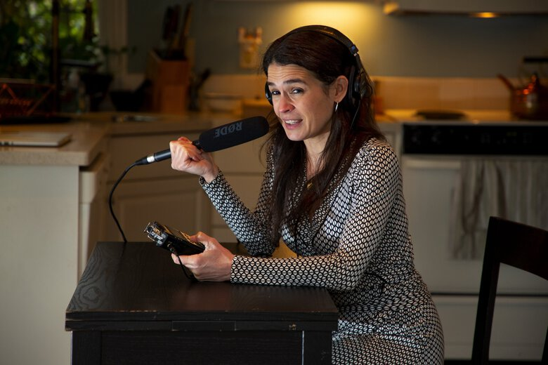 """Katy Sewall records an  intro for her podcast, """"The Bittersweet Life,"""" from her Seattle kitchen. Sewall and podcast partner Tiffany Parks (not shown), who lives in Rome, began the podcast in 2014, when the two childhood friends reconnected in Italy and decided to explore the highs and lows of the  expat experience. (Mike Siegel / The Seattle Times)"""