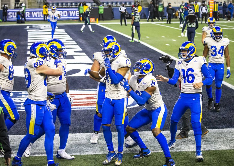 Rams wide receiver Robert Woods celebrates a fourth-quarter touchdown, which pulled the Rams ahead 30-13 as the Seattle Seahawks take on the Los Angeles Rams for a wild card playoff game at Lumen Field in Seattle Saturday January 9, 2021.  (Bettina Hansen / The Seattle Times)