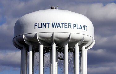 FILE – In this March 21, 2016, file photo, the Flint Water Plant water tower is seen in Flint, Mich. Former Michigan Gov. Rick Snyder, Nick Lyon, former director of the Michigan Department of Health and Human Services, and other ex-officials have been told they're being charged after a new investigation of the Flint water scandal, which devastated the majority Black city with lead-contaminated water and was blamed for a deadly outbreak of Legionnaires' disease in 2014-15, The Associated Press has learned. (AP Photo/Carlos Osorio, File) CER204 CER204