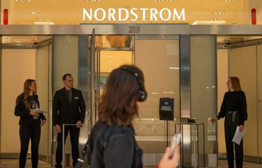 A woman walks by the front entrance to Nordstrom's new flagship store in New York City on Oct. 21, 2019. As many other retailers are downsizing, Nordstrom has reportedly spent $500 million on their new flagship store on 57th St. and Broadway. 211855