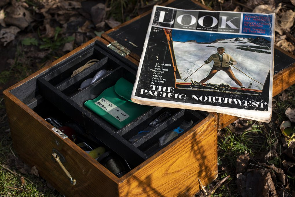 Dean Ballard's father, Jack Ballard, and their family were featured in a 1962 photo spread in Look magazine about living the good life in Seattle. A copy of the magazine rests on Jack's old oak tackle box. (Bettina Hansen / The Seattle Times)
