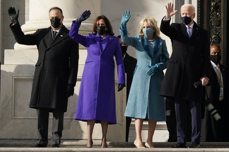 President-elect Joe Biden, his wife Jill Biden, Vice President-elect Kamala Harris and her husband Doug Emhoff arrive at the U.S. Capitol for the start of inauguration ceremonies on Wednesday. (J. Scott Applewhite / The Associated Press)