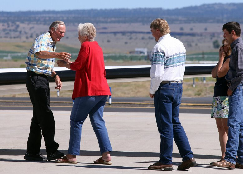 In this July 11, 2018, file photo, rancher Dwight Hammond Jr., left, is embraced by his wife, Susie Hammond, after arriving by private jet at the Burns Municipal Airport in Burns, Ore. Hammond and his son Steven, convicted of intentionally setting fires on public land in Oregon, were pardoned by President Donald Trump in 2018. The federal government on Tuesday, Jan. 19, 2021,  has awarded grazing allotments to the Hammonds, whose case sparked the takeover of a federal wildlife refuge by right-wing extremists in 2016. (Beth Nakamura / The Oregonian via The Associated Press)