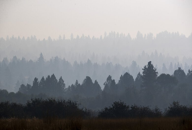 Early morning smoke hangs in the air near Keller in Eastern Washington on Sept. 9. Public Lands Commissioner Hilary Franz is asking the Legislature for a more permanent source of funding to prevent and fight wildfires. (Amanda Snyder / The Seattle Times)